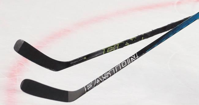 Players' sticks are shown during a World Hockey Championships game in Moscow, Russia on Thursday, May 12, 2016. A senior hockey team in a small city in southern Manitoba has changed its name following a push against the use of Indigenous names and caricatures as mascots. THE CANADIAN PRESS/AP, Ivan Sekretarev