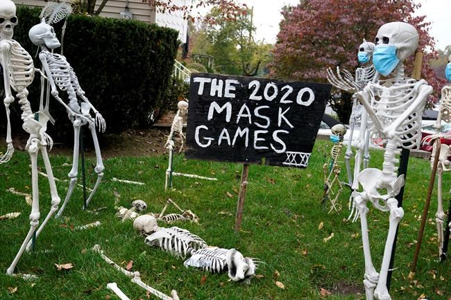 COVID-19 themed Halloween decorations are displayed on a lawn in Tenafly, N.J. on Oct. 22, 2020. THE CANADIAN PRESS/AP, Seth Wenig