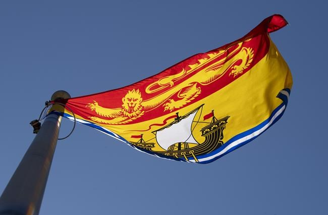 New Brunswick's provincial flag flies on a flag pole in Ottawa, Monday July 6, 2020. New Brunswick is reporting six new cases of COVID-19 and now has 19 active cases. THE CANADIAN PRESS/Adrian Wyld