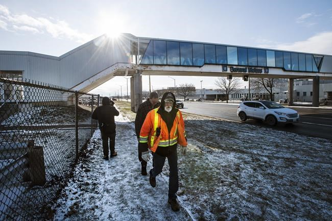 Workers leave the General Motors plant in Oshawa, Ont. on the final day of production on Wednesday, December 18, 2019. One of the biggest signs that the labour movement has its wind at its back is the revitalization of General Motors' plant in Oshawa, Ont. during negotiations with Unifor.THE CANADIAN PRESS/Aaron Vincent Elkaim