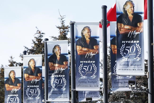 Banners in front of Canadian fashion mogul Peter Nygard's headquarters in Winnipeg are shown on Wednesday, Feb. 26, 2020. Nygard is to have a bail hearing after his arrest in Winnipeg under the Extradition Act over charges in the United States of using his influence to traffic women and girls for sex. THE CANADIAN PRESS/John Woods