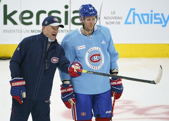 Montreal Canadiens' Corey Perry listens to assistant coach Kirk Muller during a practice in Brossard, Que. on Tuesday, January 5, 2021. Vancouver winger Loui Eriksson and Montreal Perry were among the players placed on waivers by their NHL clubs Monday as teams worked to get their rosters in order before the start of the season.THE CANADIAN PRESS/Paul Chiasson