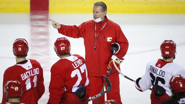 Calgary Flames head coach Geoff Ward gives instruction during a training camp practice in Calgary, Sunday, Jan. 10, 2021.THE CANADIAN PRESS/Jeff McIntosh