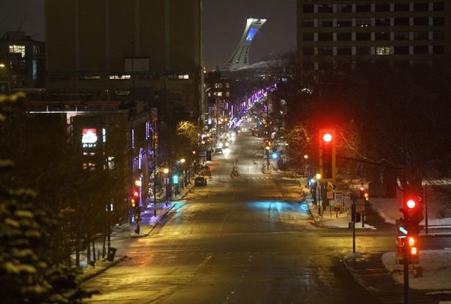 A nearly empty Mount Royal street leading up to Olympic Stadium is seen during a COVID-19 8 p.m. curfew in Montreal, on Tuesday, Jan. 12, 2021. THE CANADIAN PRESS/Paul Chiasson