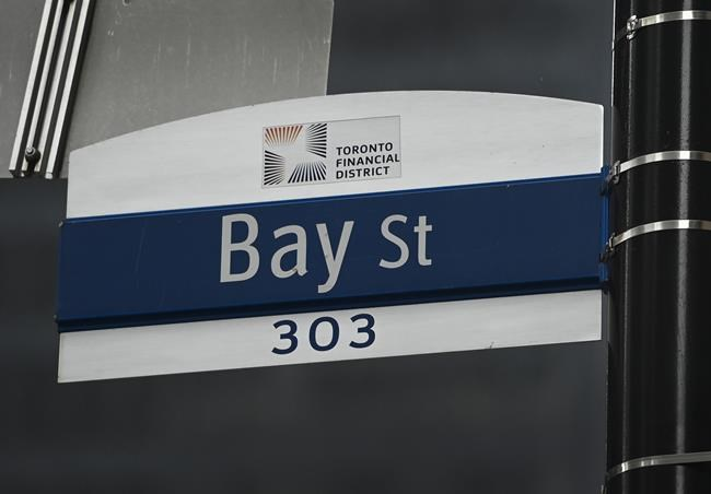 A street sign along Bay Street in Toronto's financial district is shown in Toronto on Tuesday, January 12, 2021. THE CANADIAN PRESS/Nathan Denette