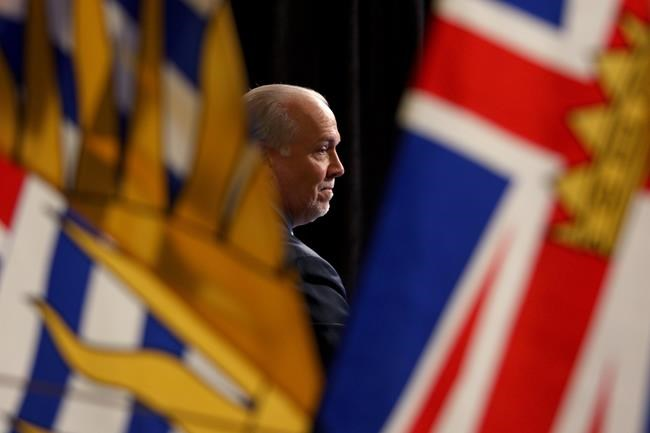 Premier John Horgan attends a press conference in the rotunda at Legislature in Victoria, B.C., on Wednesday, May 6, 2020. The B.C. government says a review of legal options made clear it cannot prevent people from travelling to the province from elsewhere in Canada. THE CANADIAN PRESS/Chad Hipolito
