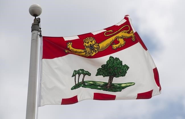 """Prince Edward Island's provincial flag flies on a flag pole in Ottawa, Friday July 3, 2020.A lozenge plant in Prince Edward Island has laid off 30 workers, citing an """"almost non-existent"""" cold and cough season amid COVID-19 restrictions. THE CANADIAN PRESS/Adrian Wyld"""