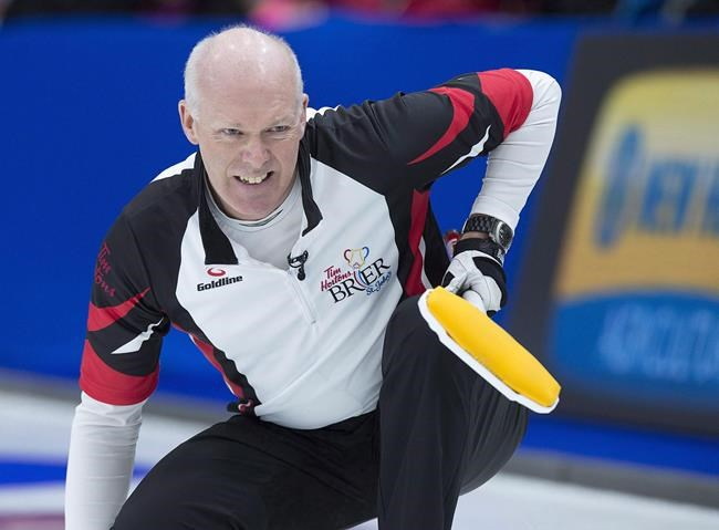 Ontario skip Glenn Howard watches a rock as they play Newfoundland and Labrador in draw 15 action at the Tim Hortons Brier curling championship at Mile One Centre in St. John's on Thursday, March 9, 2017. Curling Canada has decided to use the national ranking system as its selection criteria for the final wild-card berths at the Scotties Tournament of Hearts and Tim Hortons Brier.THE CANADIAN PRESS/Andrew Vaughan