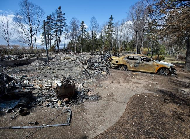 A fire-destroyed property registered to Gabriel Wortman at 200 Portapique Beach Road is seen in Portapique, N.S. on May 8, 2020. Three people who allegedly supplied ammunition to the gunman who murdered 22 people in the April 18-19 mass shooting in Nova Scotia are scheduled for court hearings today. THE CANADIAN PRESS/Andrew Vaughan