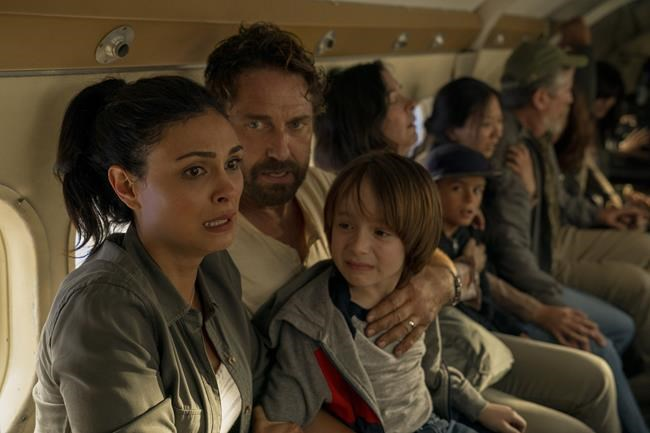 """Morena Baccarin, left, and Gerard Butler are shown in """"Greenland"""" in this undated handout photo. Gerard Butler and Morena Baccarin star as parents racing to escape a planet-killing comet in """"Greenland,"""" which arrives on Amazon Prime Video on Feb. 5. THE CANADIAN PRESS/HO - Amazon Prime, STXfilms, Daniel McFadden"""