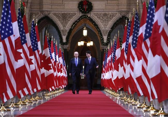Prime Minister Justin Trudeau and US vice-president Joe Biden walk down the Hall of Honour on Parliament Hill in Ottawa on Friday, December 9, 2016. THE CANADIAN PRESS/Patrick Doyle