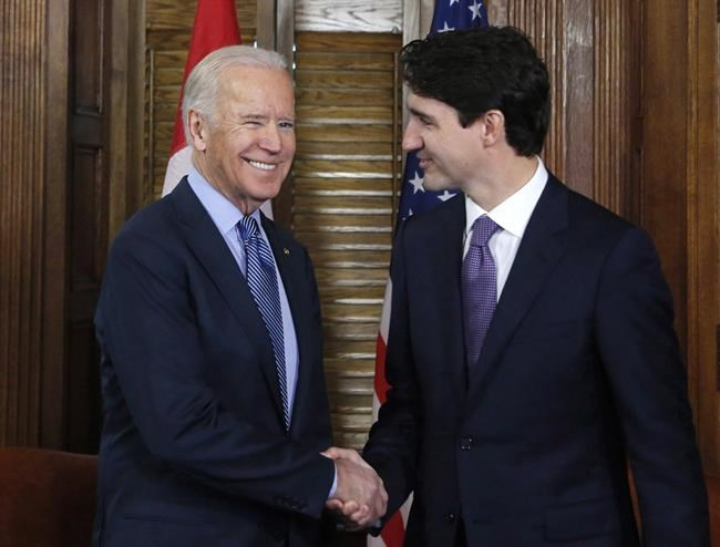Prime Minister Justin Trudeau shakes hands with U.S. Vice-President Joe Biden on Parliament Hill in Ottawa on Friday, December 9, 2016. THE CANADIAN PRESS/Patrick Doyle