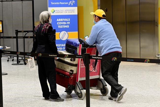 Travellers arrive at Terminal 3 at Pearson Airport in Toronto early Monday, Feb. 22, 2021. THE CANADIAN PRESS/Frank Gunn