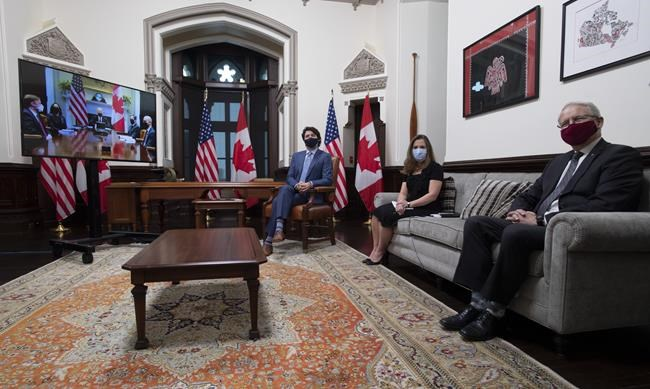 Canadian Prime Minister Justin Trudeau is seen with Deputy Prime Minister and Minister of Finance Chrystia Freeland and Foreign Affairs Minister Marc Garneau as they meet virtually with United States President Joe Biden from his office on Parliament Hill in Ottawa, Tuesday February 23, 2021. THE CANADIAN PRESS/Adrian Wyld