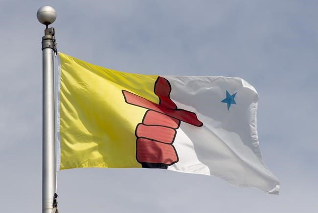 Nunavut's territorial flag flies on a flag pole in Ottawa on Tuesday, June 30, 2020. THE CANADIAN PRESS/Adrian Wyld