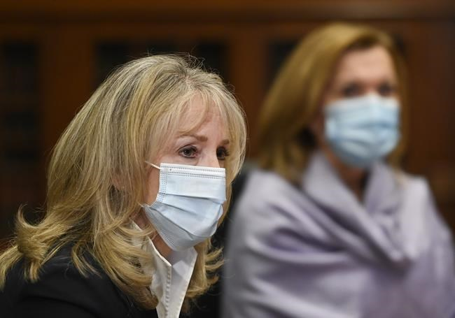Merrilee Fullerton, Ontario's Minister of Long-Term Care listens to updates regarding the Ontario COVID-19 vaccine during the COVID-19 pandemic in Toronto on Tuesday, January 5, 2021. THE CANADIAN PRESS/Nathan Denette