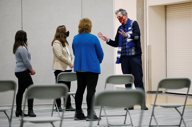 Manitoba Premier Brian Pallister got a look at the province's new COVID-19 vaccination centre at Winnipeg's Convention Centre, Friday, Jan. 1, 2021. THE CANADIAN PRESS/John Woods