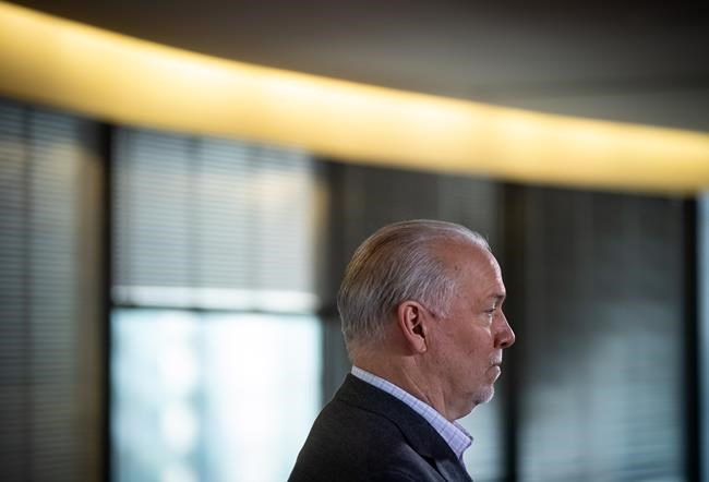 B.C. Premier John Horgan listens during a post-election news conference in Vancouver on October 25, 2020. THE CANADIAN PRESS/Darryl Dyck