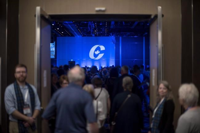 """Supporters enter the auditorium for the opening ceremony at the Conservative national convention in Halifax on Thursday, August 23, 2018. If there's been one constant at Conservative conventions since the party's first in Montreal in 2005, it's been a fellow known as """"Gord, from Red Deer.""""THE CANADIAN PRESS/Darren Calabrese"""