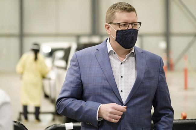Premier Scott Moe during a tour of the COVID-19 mass immunization clinic and drive-thru immunization space at International Trade Centre in Regina on Thursday, Feb. 18, 2021. THE CANADIAN PRESS/Michael Bell