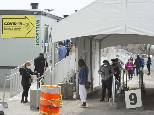 People line up at a COVID-19 testing clinic Wednesday, March 24, 2021 in Montreal. THE CANADIAN PRESS/Ryan Remiorz