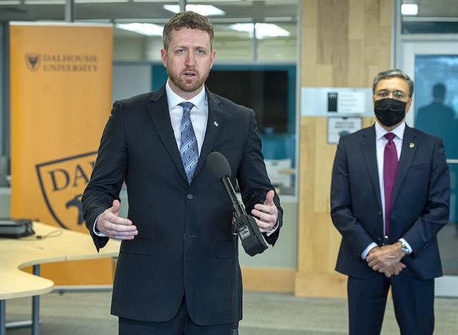 Premier Iain Rankin, left, accompanied by Deep Saini, president of Dalhousie University, fields question after touring a lab at the school in Halifax on Monday, March 29, 2021. The province recently announced a $16.8-million investment to expand and enhance computer science education at four Nova Scotia universities with $13.3 million going to Dalhousie. THE CANADIAN PRESS/Andrew Vaughan