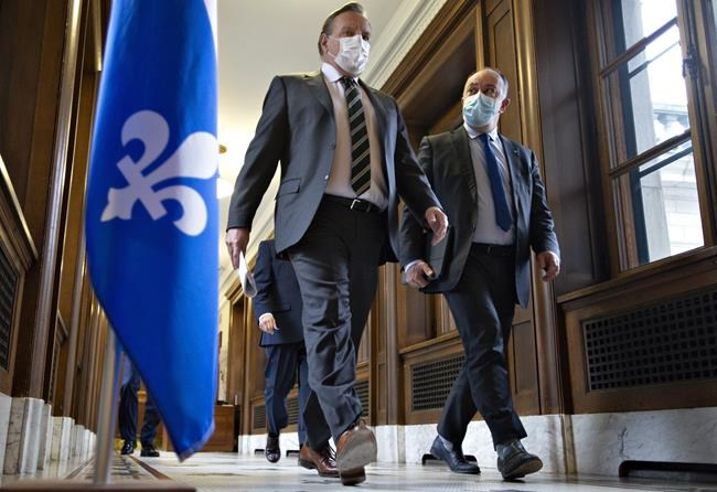 Quebec Premier Francois Legault and Quebec Health Minister Christian Dube walk to a news conference on the COVID-19 pandemic, Wednesday, March 31, 2021 at the legislature in Quebec City. THE CANADIAN PRESS/Jacques Boissinot