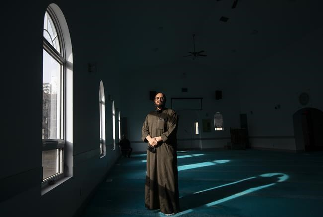 Vice-president of MCE Mosque, Jamal Osman, poses in Edmonton on Wednesday, March 31, 2021. THE CANADIAN PRESS/Jason Franson