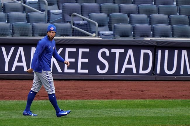 Toronto Blue Jays center fielder George Springer (4) walks on the field during a team workout, Wednesday, March 31, 2021, at Yankee Stadium in New York. The Blue Jays face the New York Yankees on opening day Thursday in New York. THE CANADIAN PRESS/AP/Kathy Willens