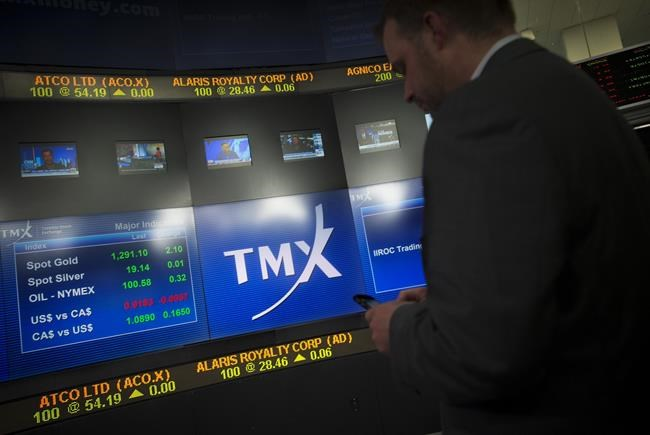 A man works in the broadcast centre at the TMX Group Ltd. in Toronto, on May 9, 2014. THE CANADIAN PRESS/Darren Calabrese