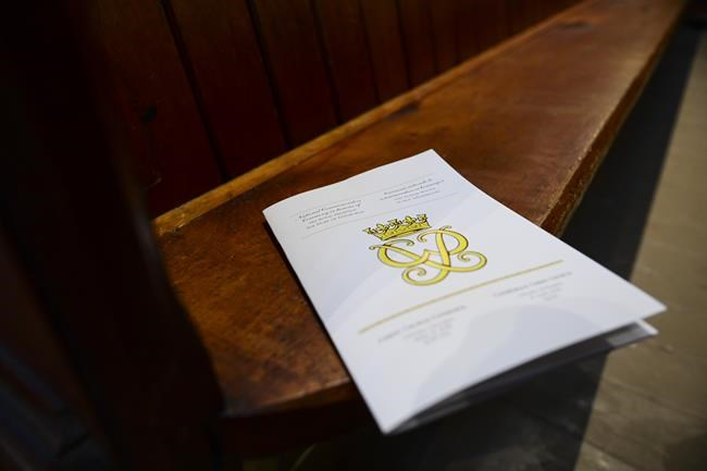 The official program for the National Commemorative Ceremony in honour of Prince Philip, The Duke of Edinburgh, sits on an empty pew prior to the ceremony at Christ Church Cathedral in Ottawa on Saturday, April 17, 2021. THE CANADIAN PRESS/Sean Kilpatrick