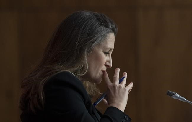 Minister of Finance Chrystia Freeland listens to a questionduring a news conference in Ottawa, Monday April 19, 2021. Freeland will deliver the government's first budget since the COVID-19 pandemic began. THE CANADIAN PRESS/Adrian Wyld