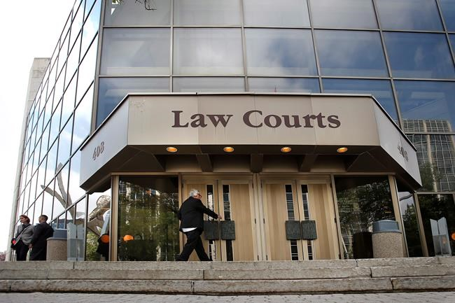 The Manitoba Law Courts building is shown in downtown Winnipeg, Monday, Aug. 18, 2014.  THE CANADIAN PRESS/John Woods