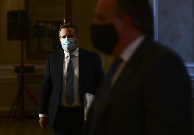 Alberta Premier Jason Kenney and Quebec Premier Francois Legault leave a press conference in Ottawa, Friday, Sept. 18, 2020. Alberta teachers, child-care workers and support staff will now be allowed to book COVID-19 vaccine appointments. THE CANADIAN PRESS/Sean Kilpatrick