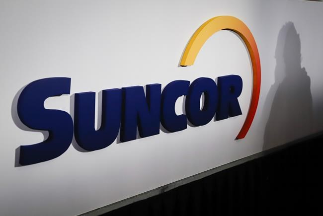 A Suncor logo is shown at the company's annual meeting in Calgary, Alta., Thursday, May 2, 2019. THE CANADIAN PRESS/Jeff McIntosh