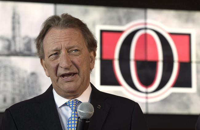 Ottawa Senators owner Eugene Melnyk speaks with the media in Ottawa, Thursday, Sept. 7, 2017. Ottawa Senators owner Eugene Melnyk is not commenting on separate lawsuits filed about a Caribbean cruise he took over Christmas. THE CANADIAN PRESS/Adrian Wyld