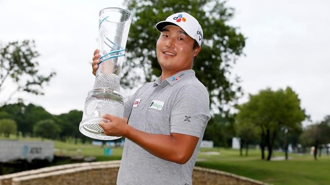 Kyoung-Hoon Lee, of South Korea, holds the trophy on the 18th green after winning the AT&T Byron Nelson golf tournament in McKinney, Texas, Sunday, May 16, 2021. (AP Photo/Ray Carlin)