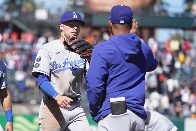 Los Angeles Dodgers' Gavin Lux, left, celebrates with manager Dave Roberts after the Dodgers defeated the San Francisco Giants in a baseball game in San Francisco, Sunday, May 23, 2021. (AP Photo/Jeff Chiu)
