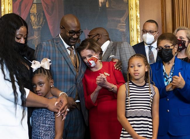 Speaker of the House Nancy Pelosi, D-Calif, center, talks with Philonise Floyd, the brother of George Floyd, left, as Rep. Karen Bass, D-Calif., right, looks on, as they stand for a photo during a meeting with Floyd family and Congressional members, Tuesday, May 25, 2021 at the Capitol in Washington. (Bill Clark/Pool via AP)