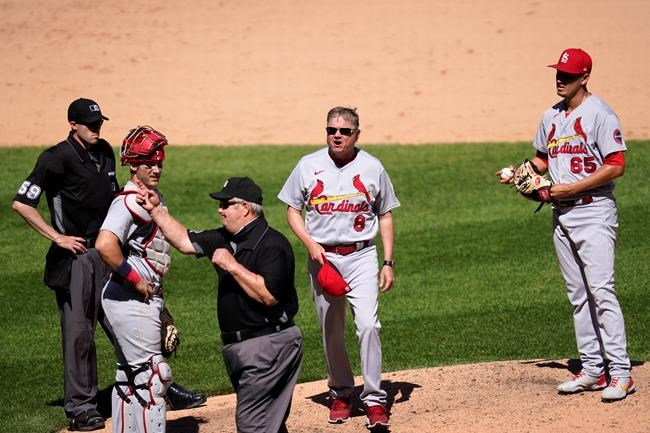 Third base umpire Joe West, center, tosses St. Louis Cardinals manager Mike Shildt (8) as home plate umpire Nic Lentz. catcher Andrew Knizner and relief pitcher Giovanny Gallegos watch during the seventh inning of an interleague baseball game against the Chicago White Sox Wednesday, May 26, 2021, in Chicago. (AP Photo/Charles Rex Arbogast)