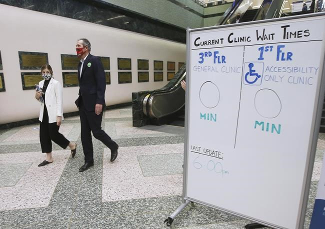 Manitoba Premier Brian Pallister leaves the convention centre after getting a COVID-19 vaccination from Dr. Brent Roussin, chief provincial public health officer, in Winnipeg, Thursday, April 8, 2021. THE CANADIAN PRESS/John Woods