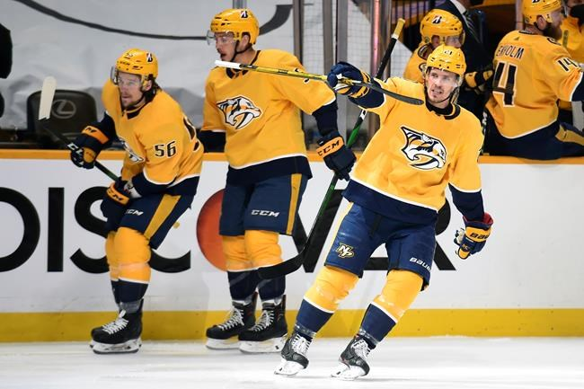Nashville Predators center Nick Cousins (21) celebrates after scoring a goal against the Carolina Hurricanes during the first period in Game 6 of an NHL hockey Stanley Cup first-round playoff series Thursday, May 27, 2021, in Nashville, Tenn. (AP Photo/Mark Zaleski)