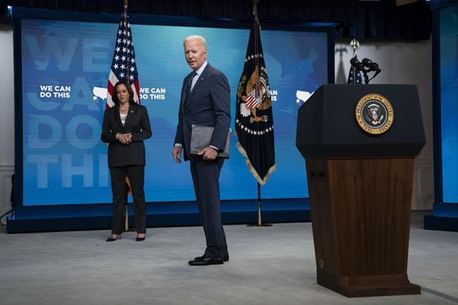Vice President Kamala Harris listens as President Joe Biden answers a question after speaking about the COVID-19 vaccination program, in the South Court Auditorium on the White House campus, Wednesday, June 2, 2021, in Washington. (AP Photo/Evan Vucci)