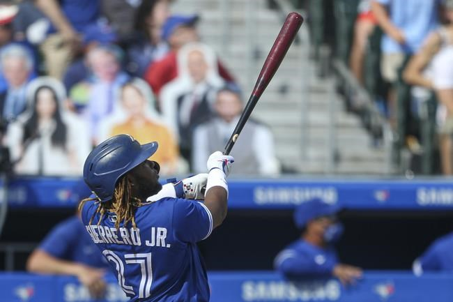 Toronto Blue Jays' Vladimir Guerrero Jr. (27) watches his two-run home run sail over the wall during the fifth inning of the team's baseball game against the Houston Astros in Buffalo, N.Y., Saturday, June 5, 2021. (AP Photo/Joshua Bessex)