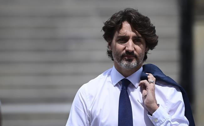 Prime Minister Justin Trudeau makes his way to hold a press conference in Ottawa on Tuesday, June 8, 2021. THE CANADIAN PRESS/Sean Kilpatrick