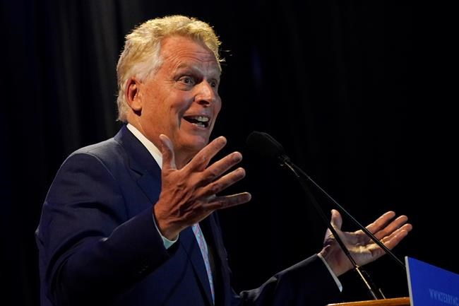 Winner of the Virginia Democratic gubernatorial primary, former Virginia Gov. Terry McAuliffe, gestures as he addresses the crowd during an election party in McLean, Va., Tuesday, June 8, 2021. McAuliffe faced four other Democrats in Tuesday's primary. (AP Photo/Steve Helber)