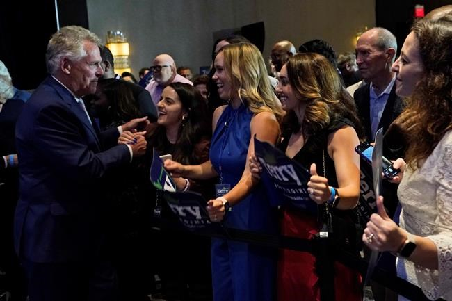 Winner of the Virginia Democratic gubernatorial primary, former Virginia Gov. Terry McAuliffe, left, greets supporters during an election party in McLean, Va., Tuesday, June 8, 2021. McAuliffe faced four other Democrats in Tuesday's primary. (AP Photo/Steve Helber)
