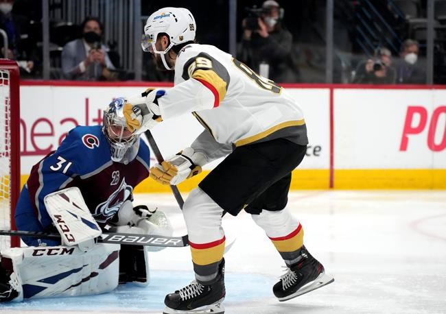 Vegas Golden Knights right wing Alex Tuch, right, scores a goal past Colorado Avalanche goaltender Philipp Grubauer in the third period of Game 5 of an NHL hockey Stanley Cup second-round playoff series Tuesday, June 8, 2021, in Denver. (AP Photo/David Zalubowski)