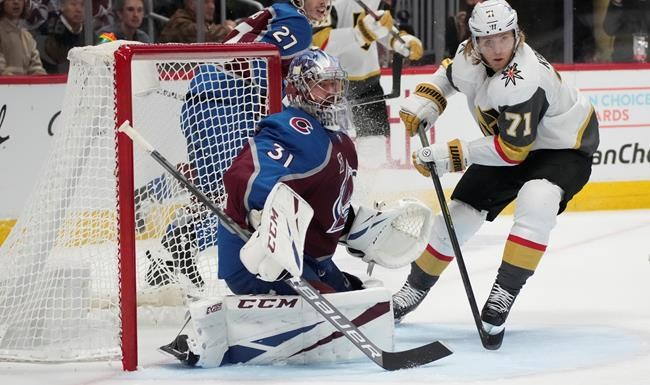 Colorado Avalanche goaltender Philipp Grubauer, left, stops a shot by Vegas Golden Knights center William Karlsson during the third period of Game 5 of an NHL hockey Stanley Cup second-round playoff series Tuesday, June 8, 2021, in Denver. (AP Photo/David Zalubowski)