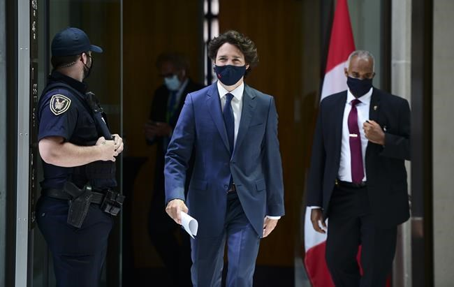 Prime Minister Justin Trudeau arrives to hold a press conference in Ottawa on Tuesday, June 8, 2021. Trudeau leaves Canada today for a G7 summit as the country is seized by tragedy and demands of justice for Indigenous peoples and Muslims. THE CANADIAN PRESS/Sean Kilpatrick